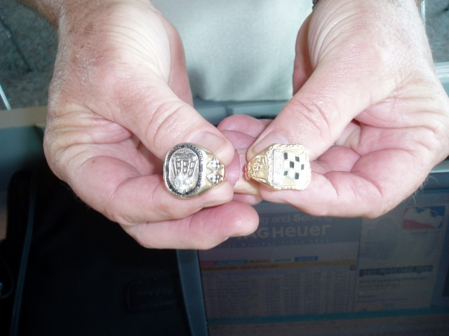 Rodger Ward Jr holds his Dad's 500 winning rings