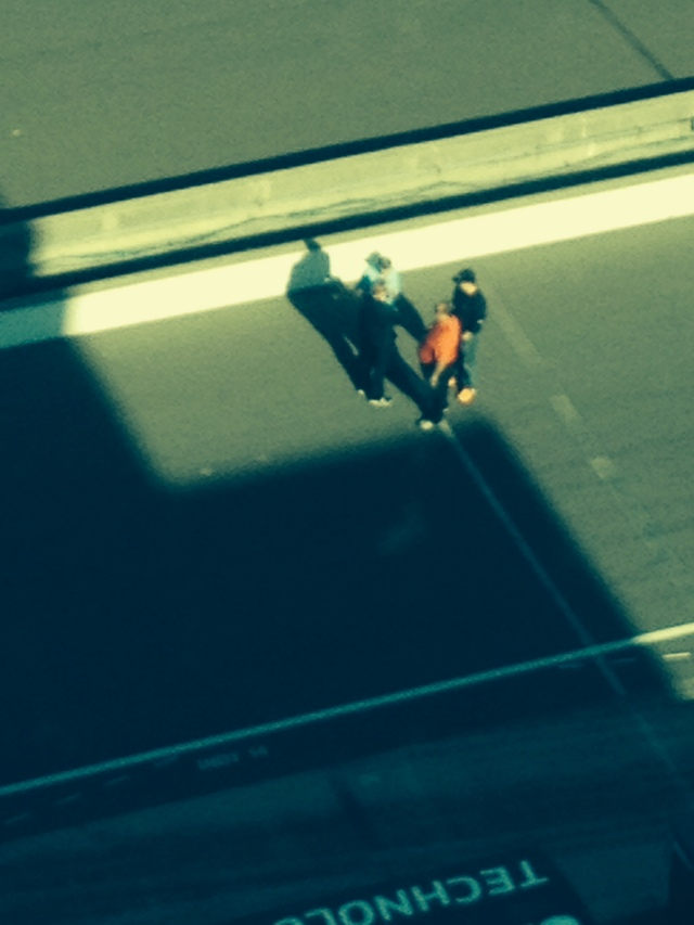 Donald Davidson on pit lane watching vintage cars. Taken from the 9th floor of the pagoda